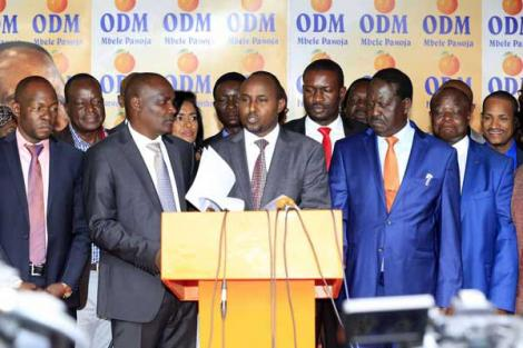 Minority Whip in the National Assembly Junet Mohammed (centre) ODM leader Rails Odinga (right) and the leader of the Minority in the National Assembly John Mbadi address the press at Orange House on March 18, 2018.