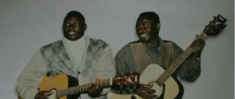 Kenyan musician John Wanyoike Corona and his brother of the Kinangop Corona Boys Band.