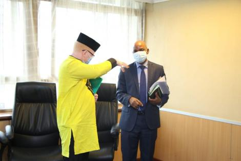 Nominated MP Isaac Mwaura (Left) with Social Protection PS Nelson Marwa on Thursday, May 7.