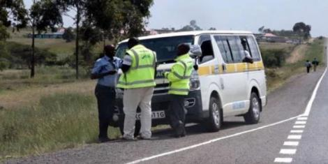 NTSA officials pictured inspecting a matatu on the Nairobi-Nakuru Highway in December 2019