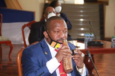 Nairobi Governor Mike Sonko drinking from a Hennessy Whisky bottle during his Senate hearing on Wednesday, July 15, 2020.