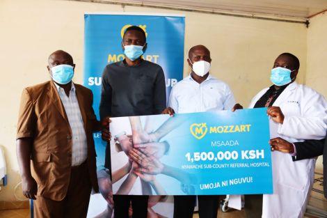 Mozzart Kenya team gives Nyamache sub-county referral hospital in Kisii a dummy check for Ksh 1.5 million