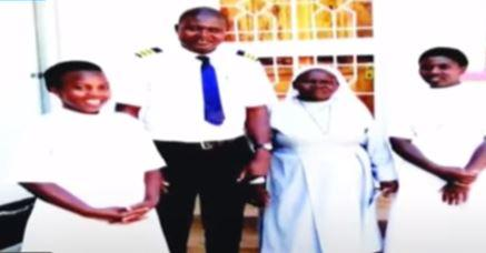 Daniel Odongo poses with Sisters from the Catholic convent St Peters Mumias.