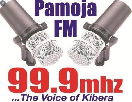 A poster advertising Pamoja FM located in Kibra, Nairobi.