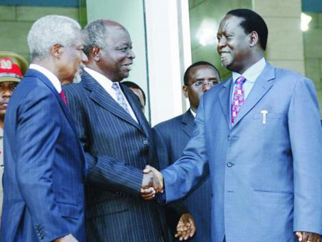 President Mwai Kibaki and Prime Minister Raila Odinga shake hands as Former UN Secretary General applauds in this January 26, 2008