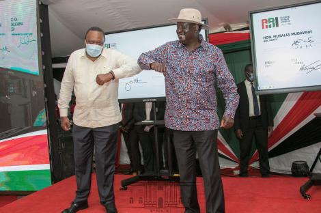 President Uhuru Kenyatta (Left) and Raila Odinga at KICC in Nairobi for the National launch of BBI signatures collection exercise. November 25, 2020.
