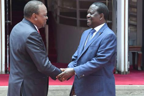 President Uhuru Kenyatta (left) and ODM party leader Raila Odinga shaking hands outside Harambee House on March 9, 2018.