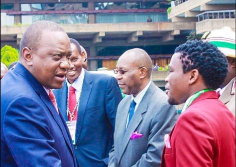 President Uhuru Kenyatta (left) greets Comedian and Nacada Director Vincent Muasya popularly known as Chipukeezy.