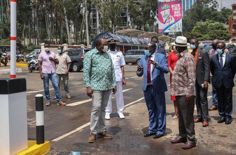 President Uhuru Kenyatta (in green shirt) and former Prime Minister Raila Odinga (in brown shirt) at Green Park Terminus on Thursday April 1, 2021.