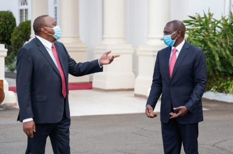 President Uhuru Kenyatta and his deputy William Ruto share a light moment at State House Nairobi