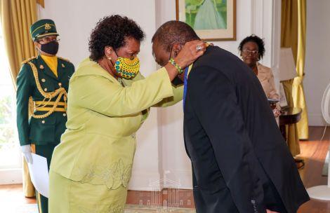 President Uhuru Kenyatta awarded by Governor of Barbados Dame Sandra Mason at Government House in Bridgetown.