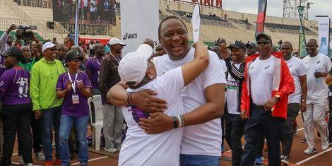 President Uhuru Kenyatta embraces his wife Margaret after completing his 2km run at the beyond zero half marathon on March 8, 2020.