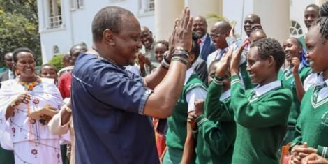 President Uhuru Kenyatta interacting with a student of Nyiro Girls' Secondary School from Baragoi (Samburu County) at State House, Nairobi on Friday, November 1, 2019