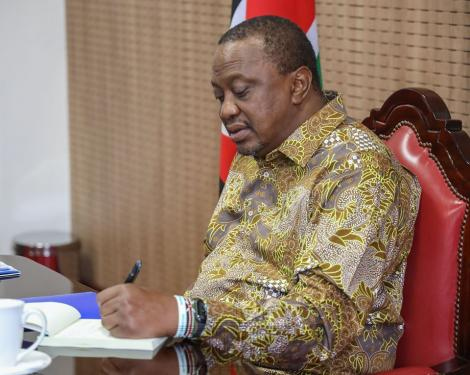 President Uhuru taking notes during the video conference meeting held with IGAD members state leaders on March 30, 2020.
