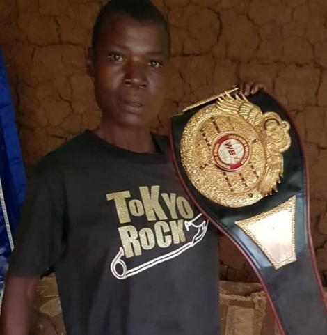 Award winning boxer Conjestina Achieng' poses for a photo after being visited by journalist Carol Radull on December 10 2020