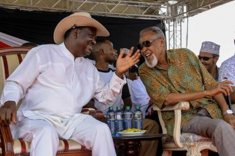 Raila Odinga and BBI taskforce head Yusuf Haji enjoy a hearty moment during the BBI Garissa rally on February 23, 2020.