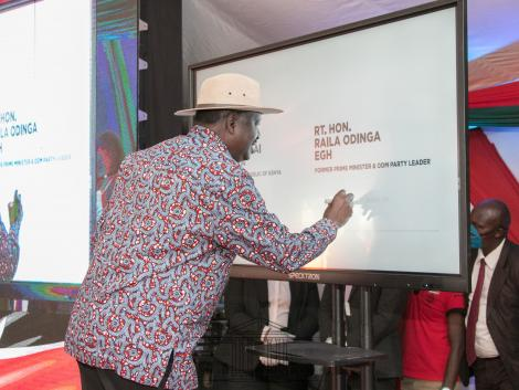 Raila Odinga signing the BBI document on November 22, 2020.