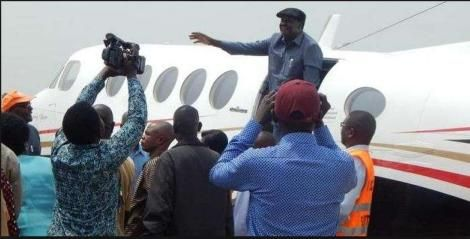 An undated photo of Opposition leader Raila Odinga aboard a plane at the airport.