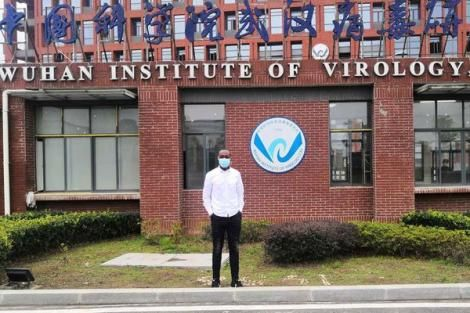 Kenyan microbiology research fellow Raphael Ohuru Nyaruaba at the main entrance of the Wuhan Institute of Virology.