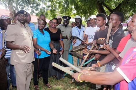 Reforming Likoni juvenile gangsters hand over weapons to security officers led by Likoni deputy county commissioner Eric Wamulevu