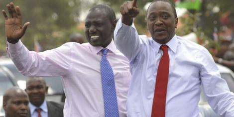 President Uhuru Kenyatta (in red tie) with his Deputy William Ruto during the 2013 elections campaigns