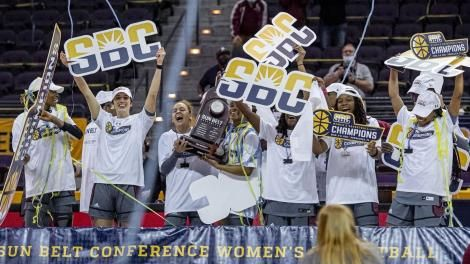 A section of Troy Trojans players celebrate after winning the Sun Belt Championship title in the US basketball league.