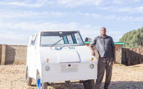 Samuel Njogu poses with his locally assembled tuk-tuk in Nyahururu town.
