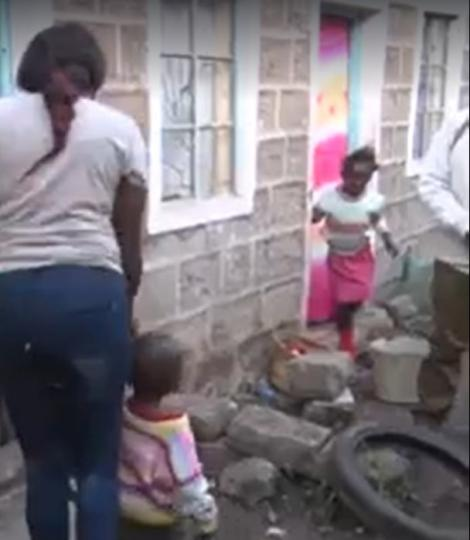 The woman who named her son Uhuru Muigai Kenyatta pictured walking with her son