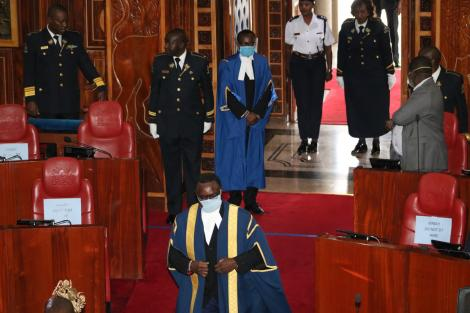 Senate Speaker Ken Lusaka makes his way to the chambers on Tuesday, March 31, 2020 donning protective gear