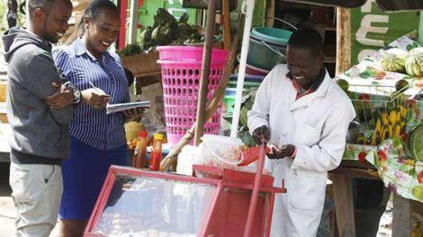 A smokie vendor pictured in Nakuru County in 2018