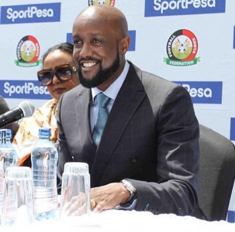 Sportpesa CEO Ronald karauri in one of Narok NYC's designs addresses the press in June 2019. On his left is Sports CS Amina Mohammed.