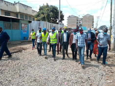 Starehe MP Charles Njagua (Centre with reflective jacket and blue helmet) conducting an inspection exercise on Mogira Road, Nairobi. June 29, 2020.