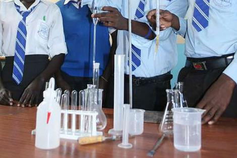 Students carrying out a science experiment in a science laboratory