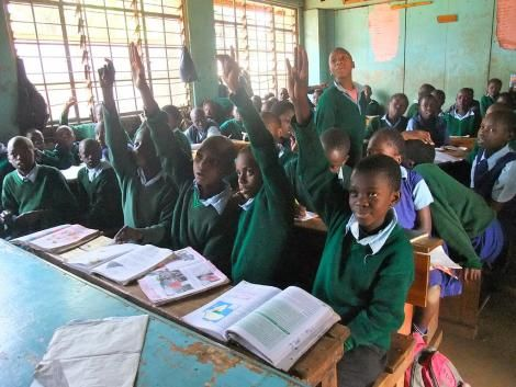 Students during a lesson at Kibra Primary School. Dr Stella Bosire studied at the school before she was expelled in Class Five.