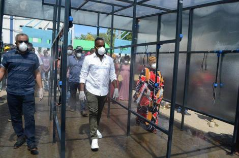 Suleiman Shabhal and Hassan Joho inspecting the newly installed public spray booth at the Likoni Crossing Channel in Mombasa.