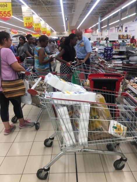 A photo of trolleys full of supplies as people shop at a Nairobi supermarket on Friday, March 13, 2020.