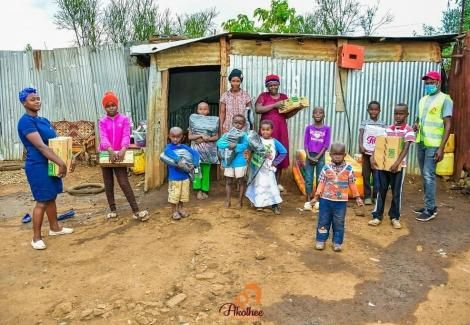 The family of 7 from Kahawa West pose for a photo after Akothee's visit on May 5, 2020.