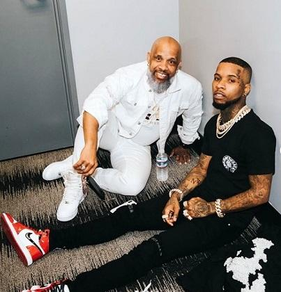 Tory Lanez with his dad Sonstar Peterson