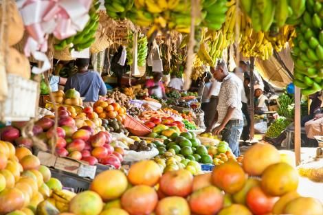 Traders and customers pictured at a market in Kenya.