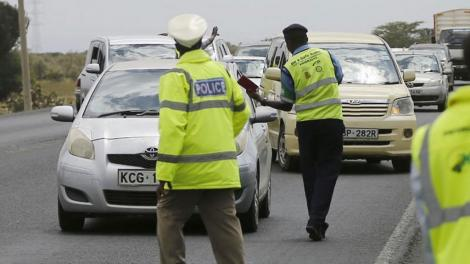Traffic police officers stop motorist at a checkpoint. On Wednesday, May 13, 2020, NTSA issued a warning to motorists.