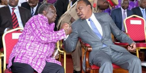 President Uhuru Kenyatta (right) with COTU boss Francis Atwoli at Uhuru Park, Nairobi, during Labour Day celebrations on May 1, 2017