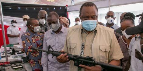 President Uhuru Kenyatta holding the Kenya-made CMZ 4 assault rifle at the KWS Law Enforcement Academy in Manyani, Taita Taveta County, October 16, 2020