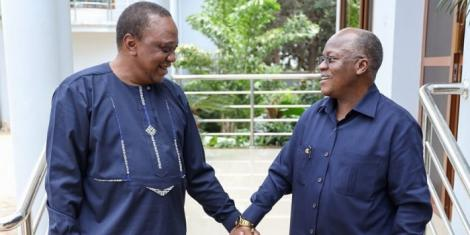 President Uhuru Kenyatta (left) and Tanzania President Pombe Magufuli (right) enjoy a light moment after the former visited the later in Tanzania in July 2019