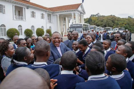 President Uhuru Kenyatta shares a light moment with high school students on August 12, 2016, at State House, Nairobi.