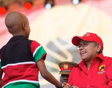 Ryan Mwenda pictured with First Lady Margaret Kenyatta at a Jubilee Party event in September 2016