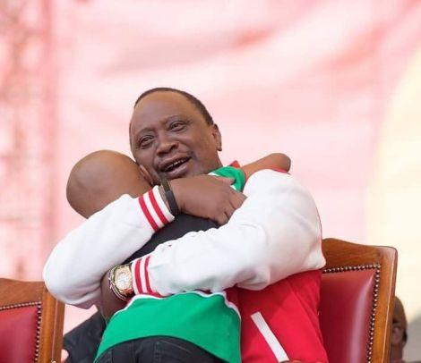 President Uhuru Kenyatta kisses Ryan Mwenda after the young artist performed at a jubilee party in September 2016