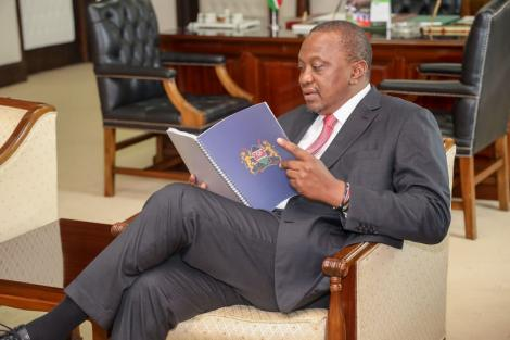 President Uhuru Kenyatta reading proposals contained in the BBI report at State House