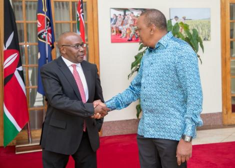 President Uhuru Kenyatta with former Attorney General Githu Muigai after he handed in his resignation letter to the at State House, Nairobi in 2018