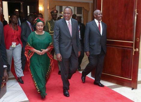President Uhuru Kenyatta walks down the red carpet with Margaret Kenyatta.