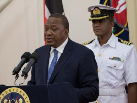 File image of President Uhuru Kenyatta with his personal aide Timothy Lekol